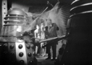 An iconic telesnap from Episode 1: dusty, seemingly-dead Daleks.  Almost certainly an in-joke about the then-recent death of Dalekmania...